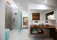 Slim-and-stylish-wood-vanity-in-white-bathroom-with-a-pop-of-blue-217x155