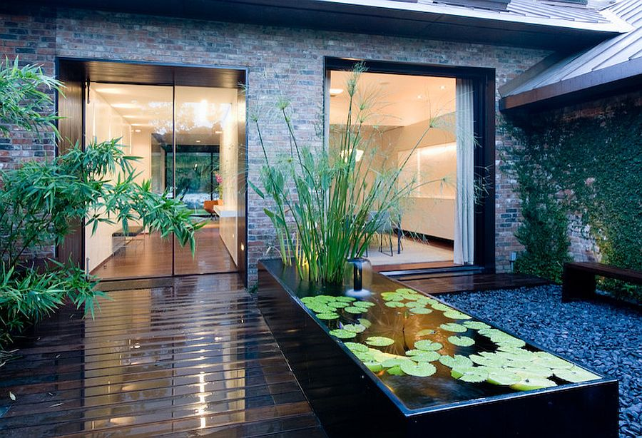 Slim water feature for the contemporary entry