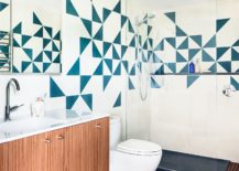 Tiles-bring-blue-color-and-pattern-to-the-bathroom-in-white-217x155