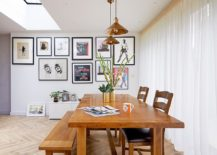 Transitional-dining-room-in-white-with-a-wooden-table-and-gallery-wall-217x155