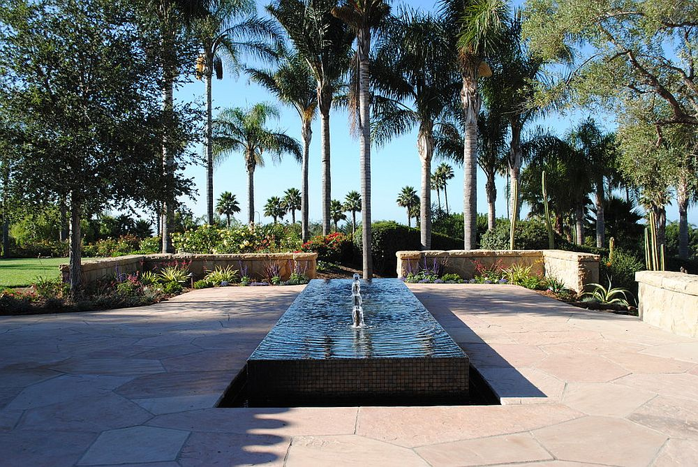 Transitional landscape with water feature is perfect for the contemporary home