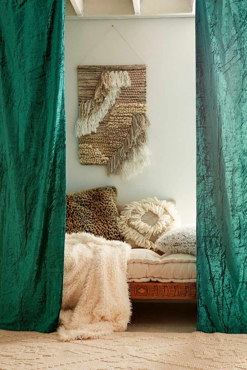 Velvet curtains in emerald add a cozy touch