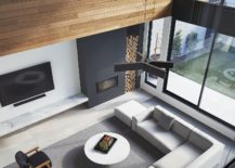 View-of-the-double-height-living-area-with-gray-fireplace-and-slim-TV-unit-217x155
