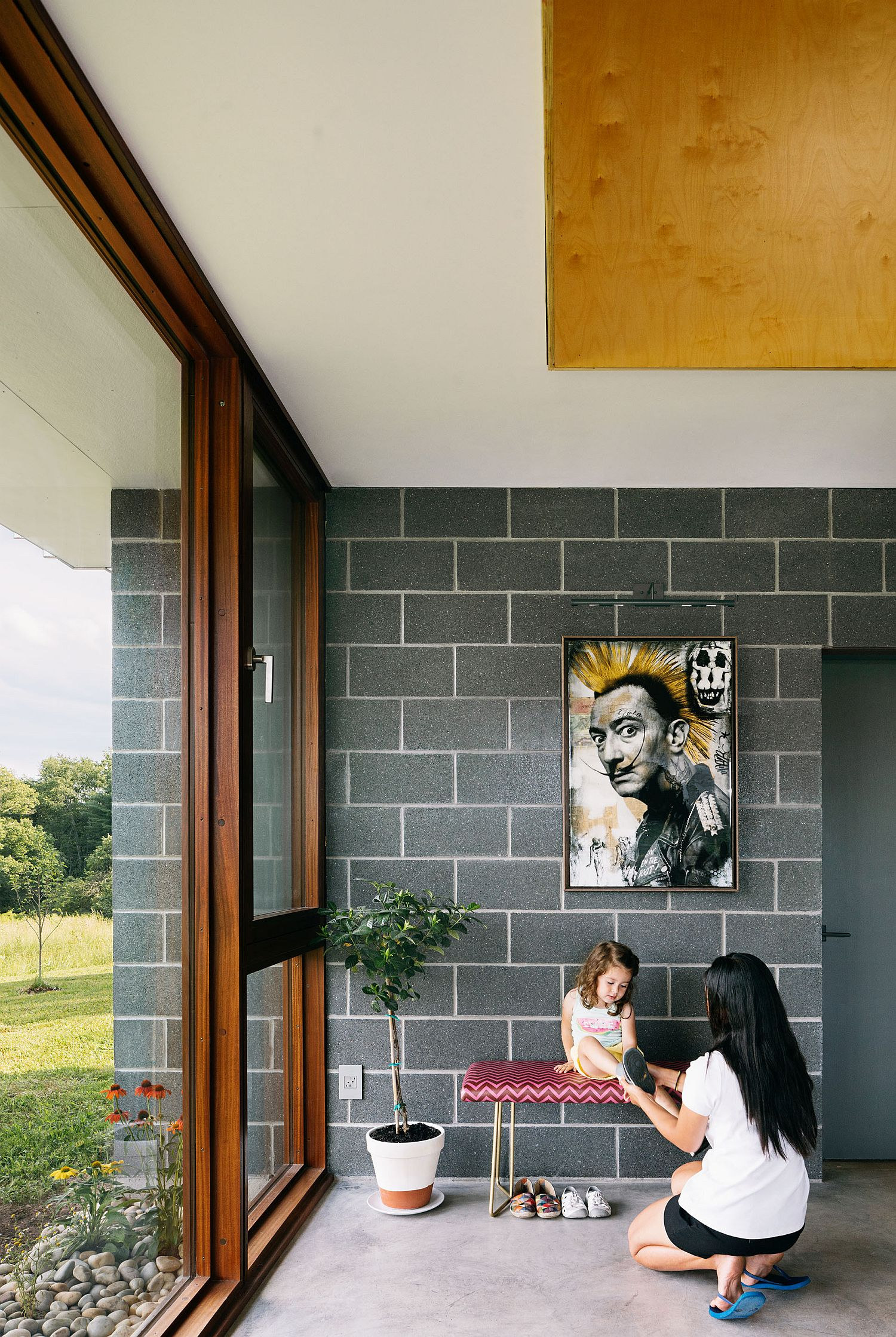 Walls in gray give the interior a distinct contemporary appeal