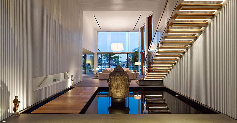 Waterbody under the stairway gives the interior a tranquil appeal