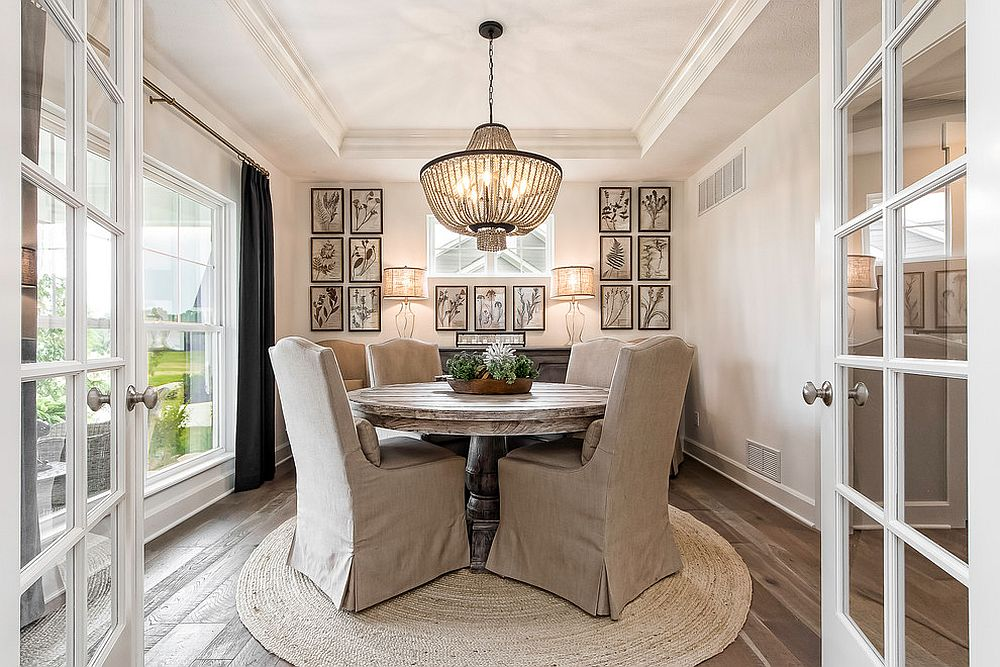 Beautifully-lit-dining-room-in-white-with-a-round-dining-table