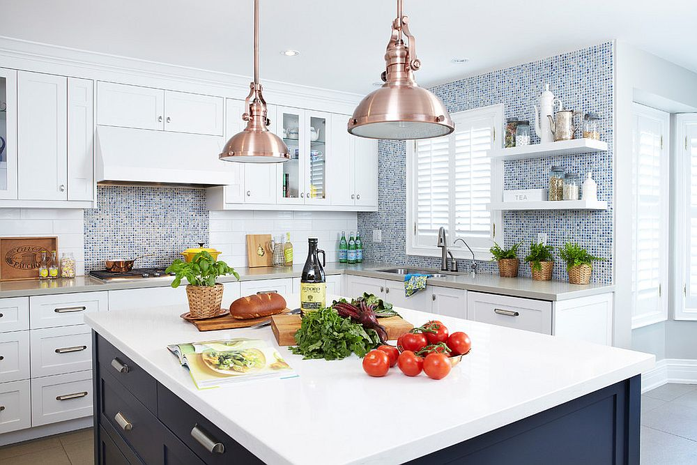 Black central island anchors the breezy kitchen in white and blue