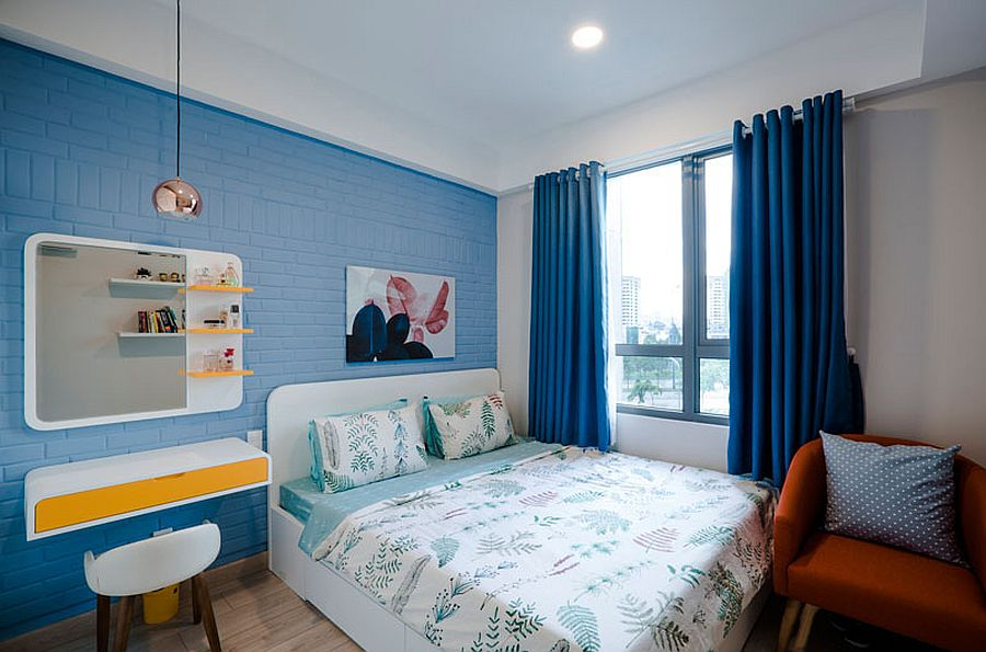 Blue and white bedroom with pops of yellow is cheerful and trendy