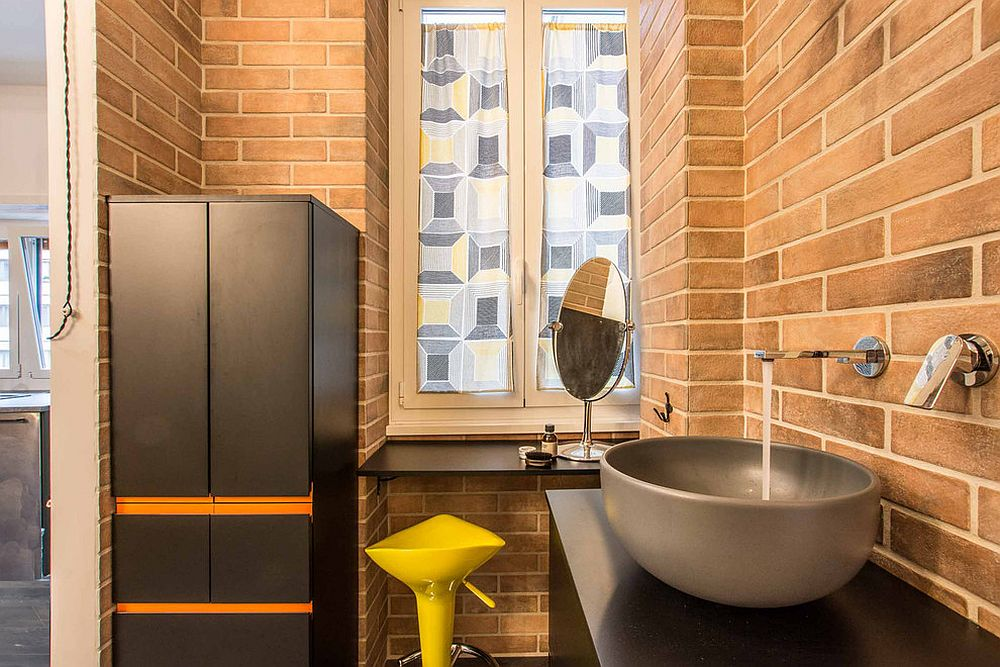 Brick walls give a lovely orange patina to this industrial bathroom