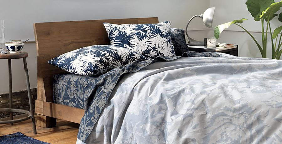 Bring in tropical style with ease using throw pillows and bedding with floral motifs from CB2