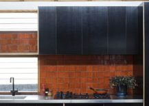 Colorful-and-weathered-backsplash-of-the-kitchen-217x155
