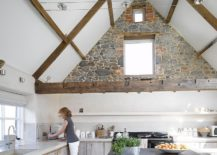 Combining-contemporary-surfaces-and-finishes-with-stone-wall-sections-in-the-kitchen-217x155
