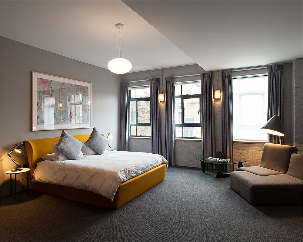 Contemporary bedroom in gray with smart yellow accent