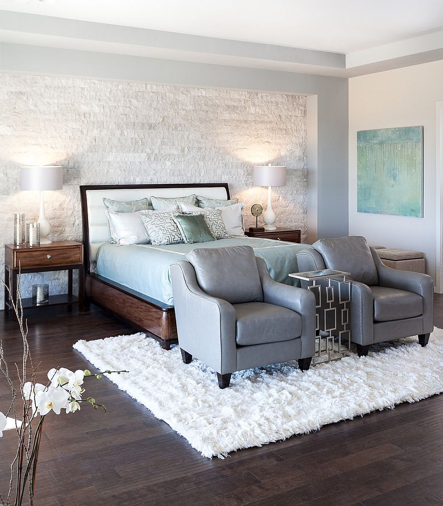 Contemporary bedroom with stone accent wall