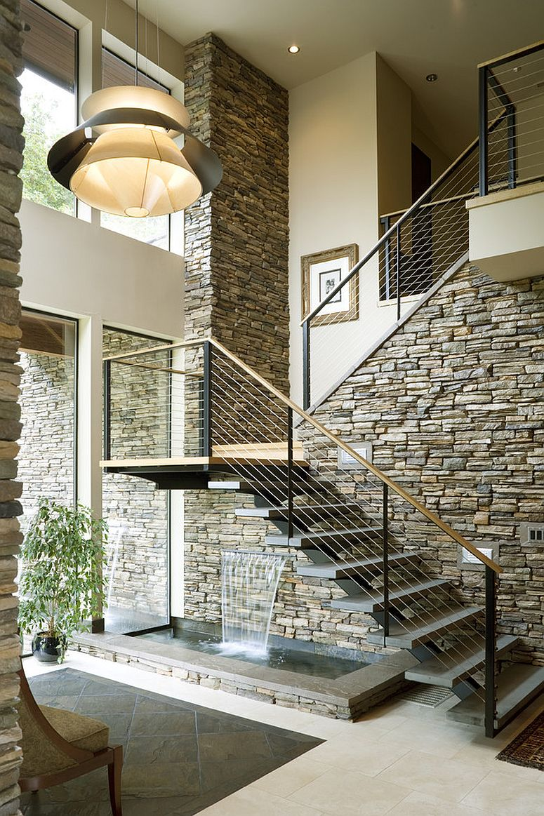 Contemporary staircase with stone wall and water feature