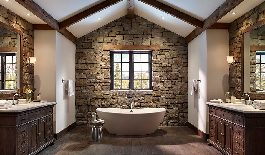 Cozy bathroom with rough cut stone walls and wooden ceiling beams