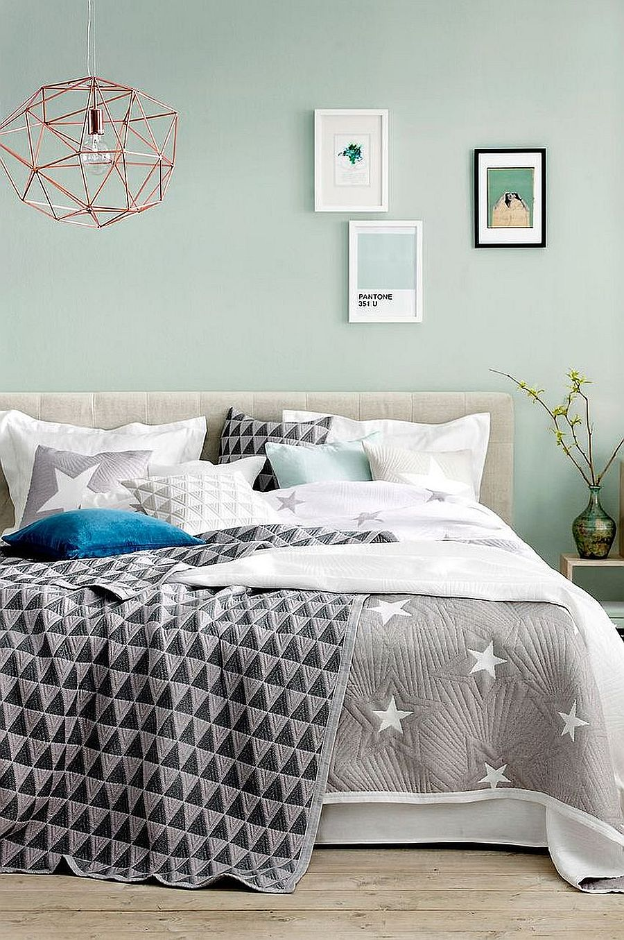 Dashing mint blue coupled with gray and white bediing in the modern bedroom