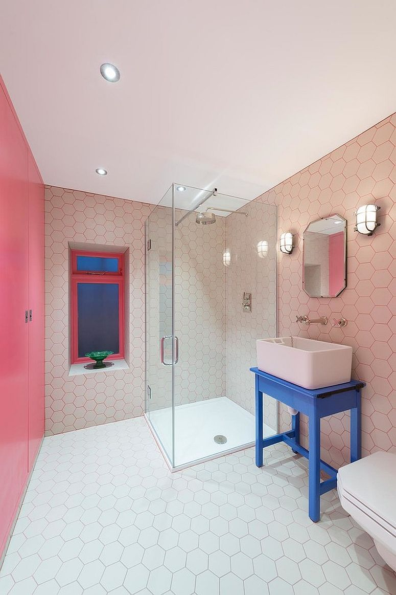 Delightful contemporary bathroom in pink with hexagonal tiles and blue accents