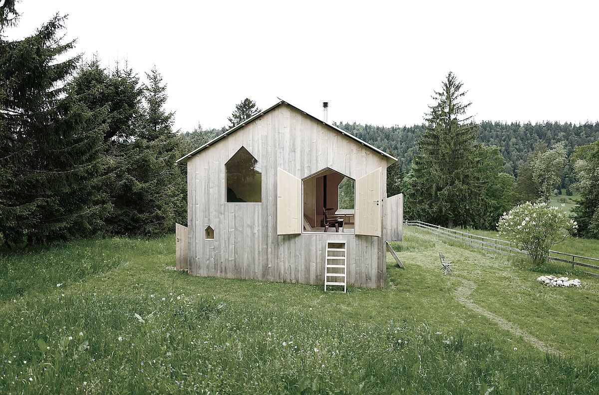 Each side of the little chalet has its own entrance and unique windows