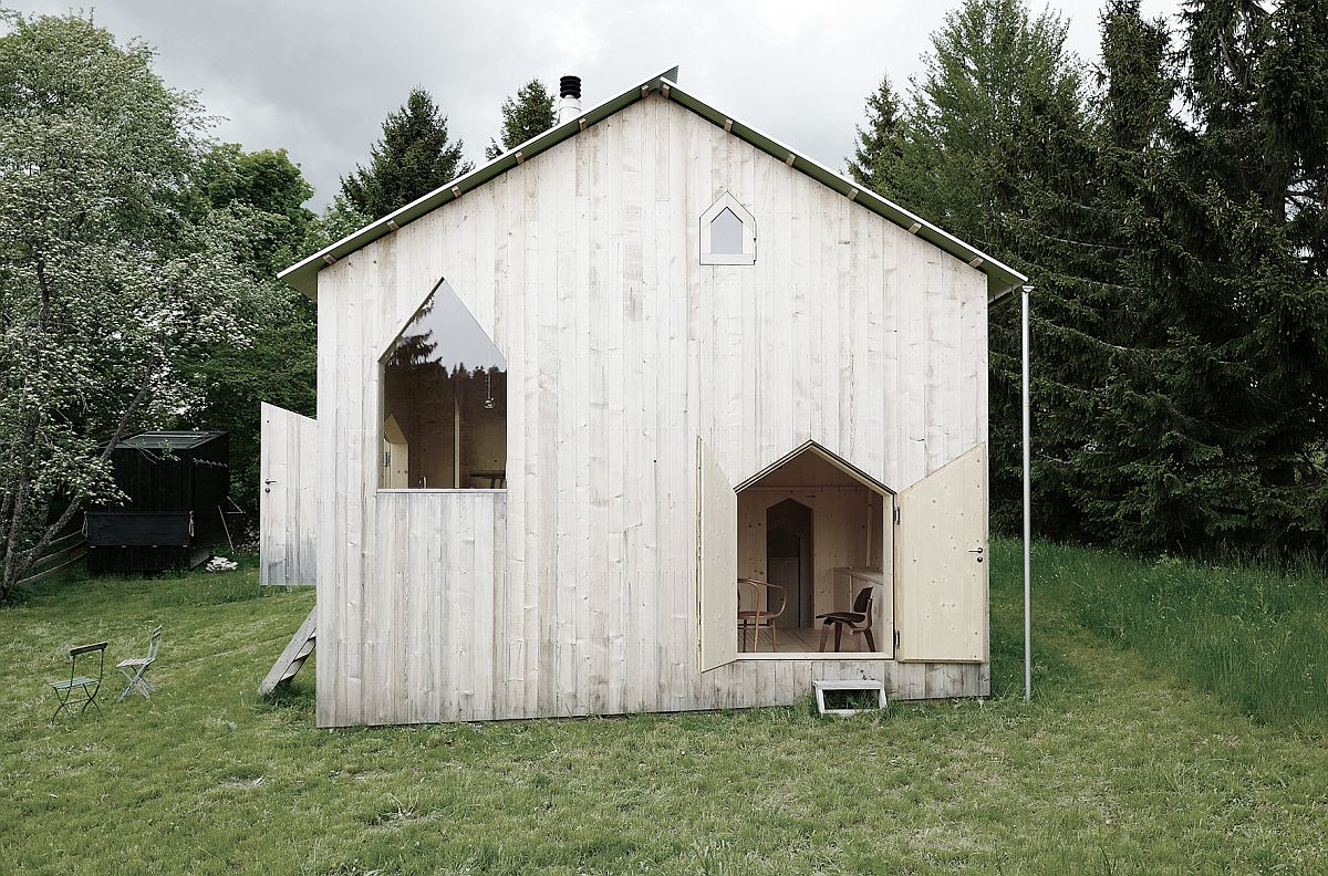 Entrance and windows of the cabin feel charmingly minimal