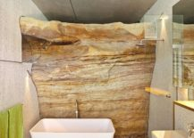 Exposed-natural-rock-beats-all-else-in-this-awesome-bathroom-217x155
