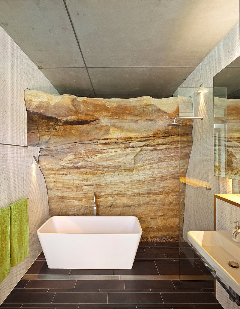 Exposed natural rock beats all else in this awesome bathroom