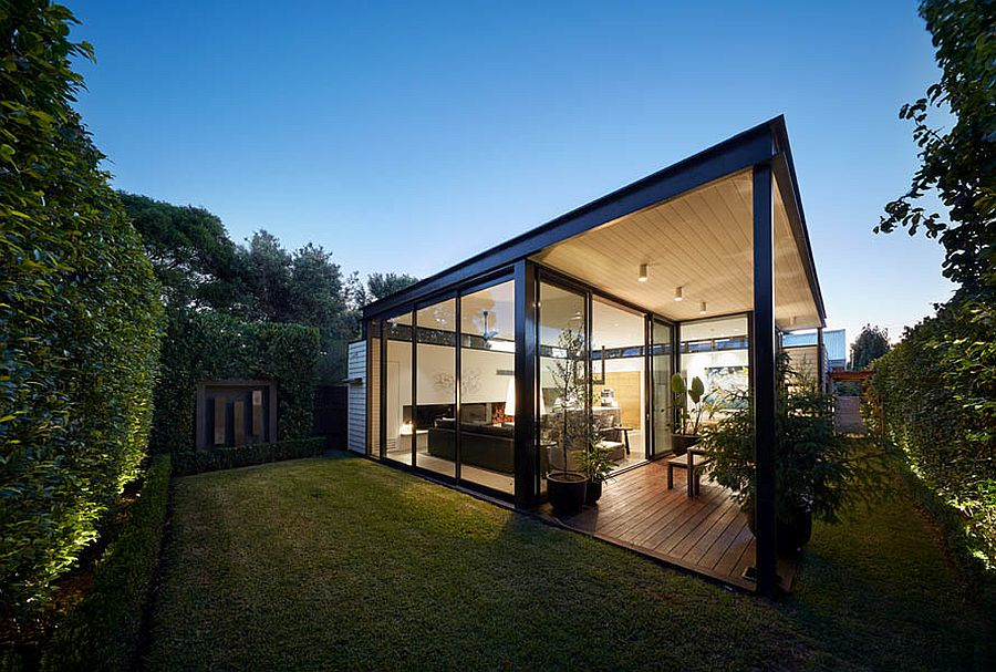 Exquisite and modern rear extension of heritage home with a glass and metal box