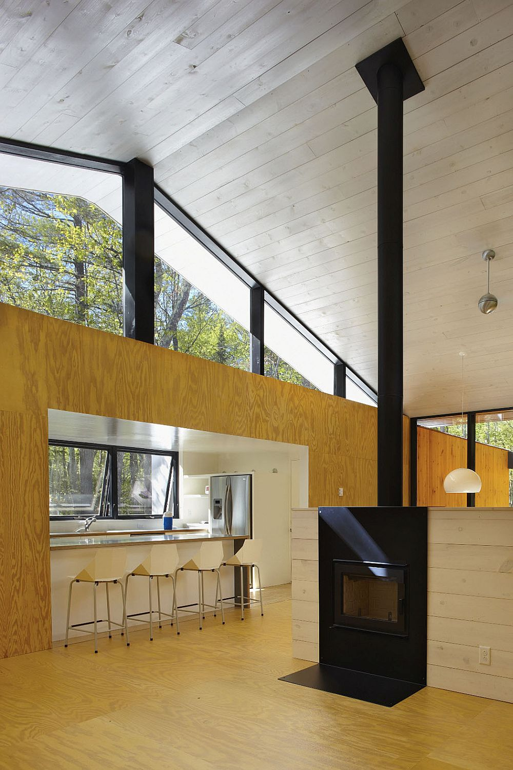Gabled roof and sweeping interiors give the weekend retreat a larger than life image!