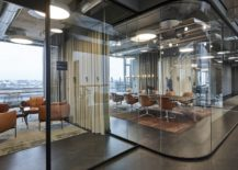 Glass-cubes-and-cubicles-throughout-the-office-create-a-tranquil-yet-social-work-environment-217x155