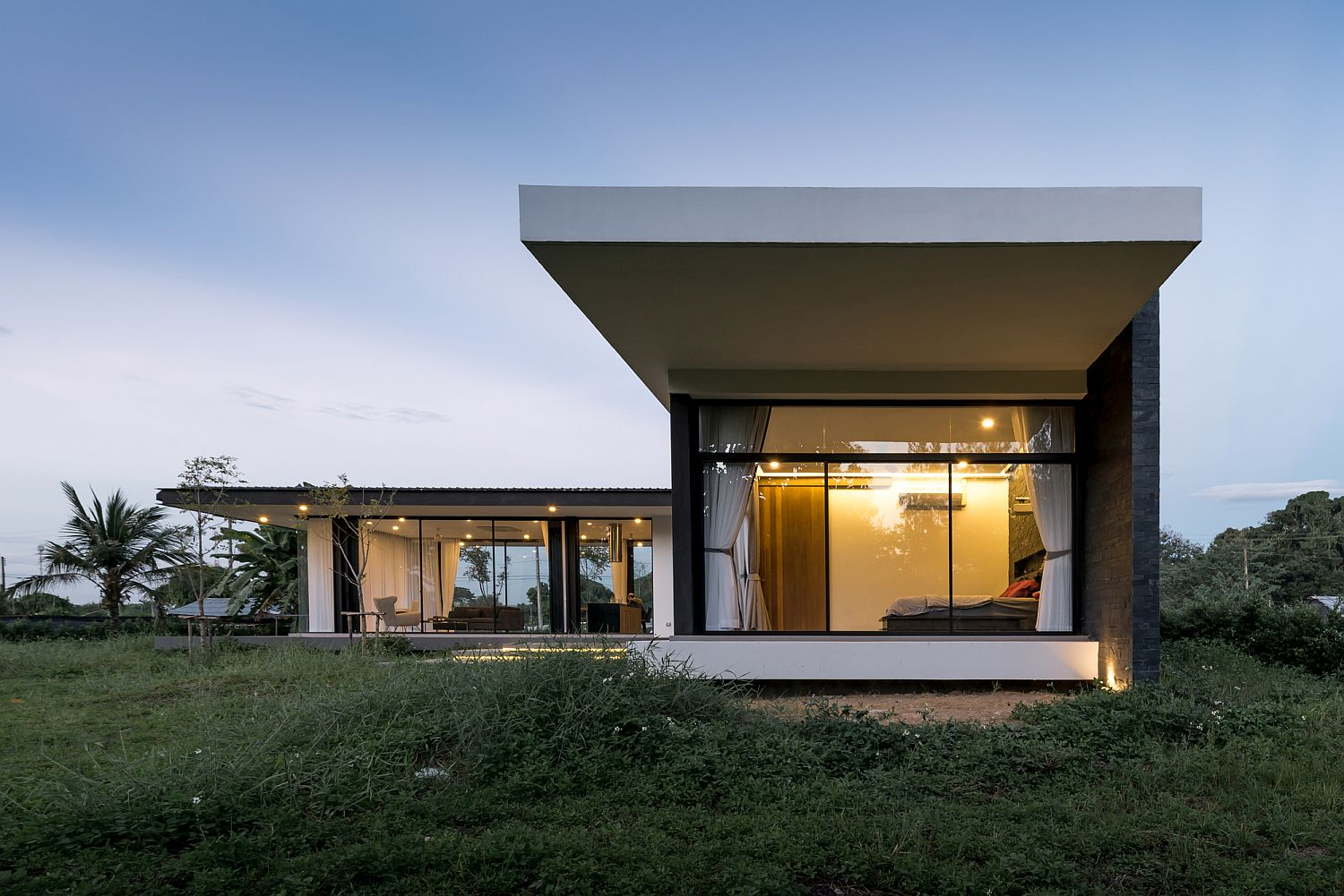 Glass walls connect the exterior with the landscape outside
