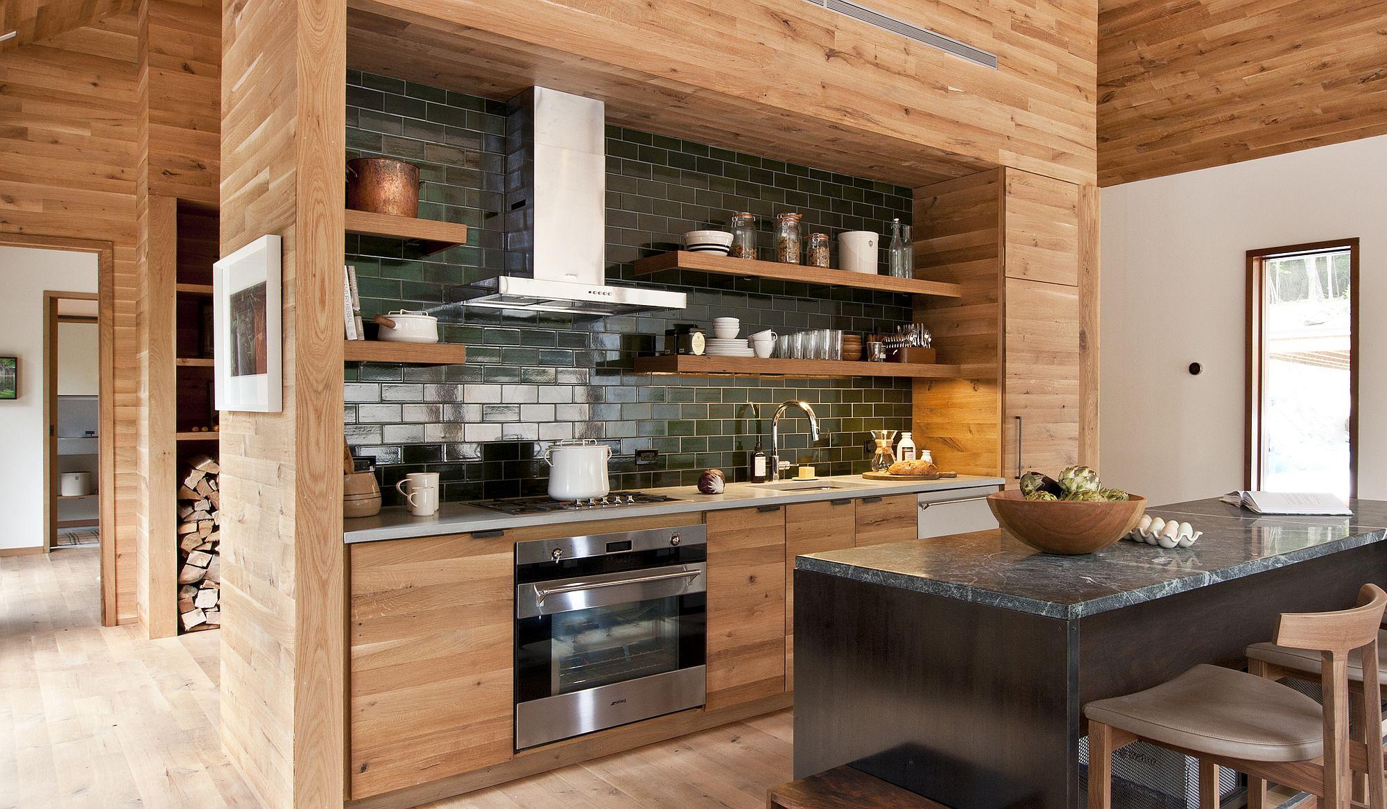 Glittering black tiled backsplash complements the kitchen island elegantly