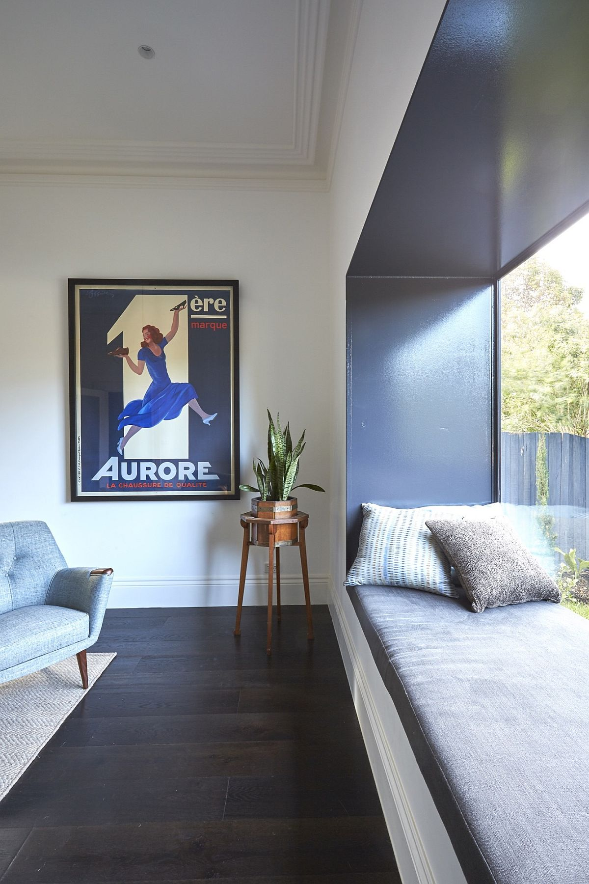 Gorgeous use of blue accents and a window seat inside the St Kilda East House