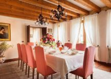 Gorgeous-Mediterranean-dining-room-with-wooden-ceiling-beams-and-pastel-pink-chairs-217x155