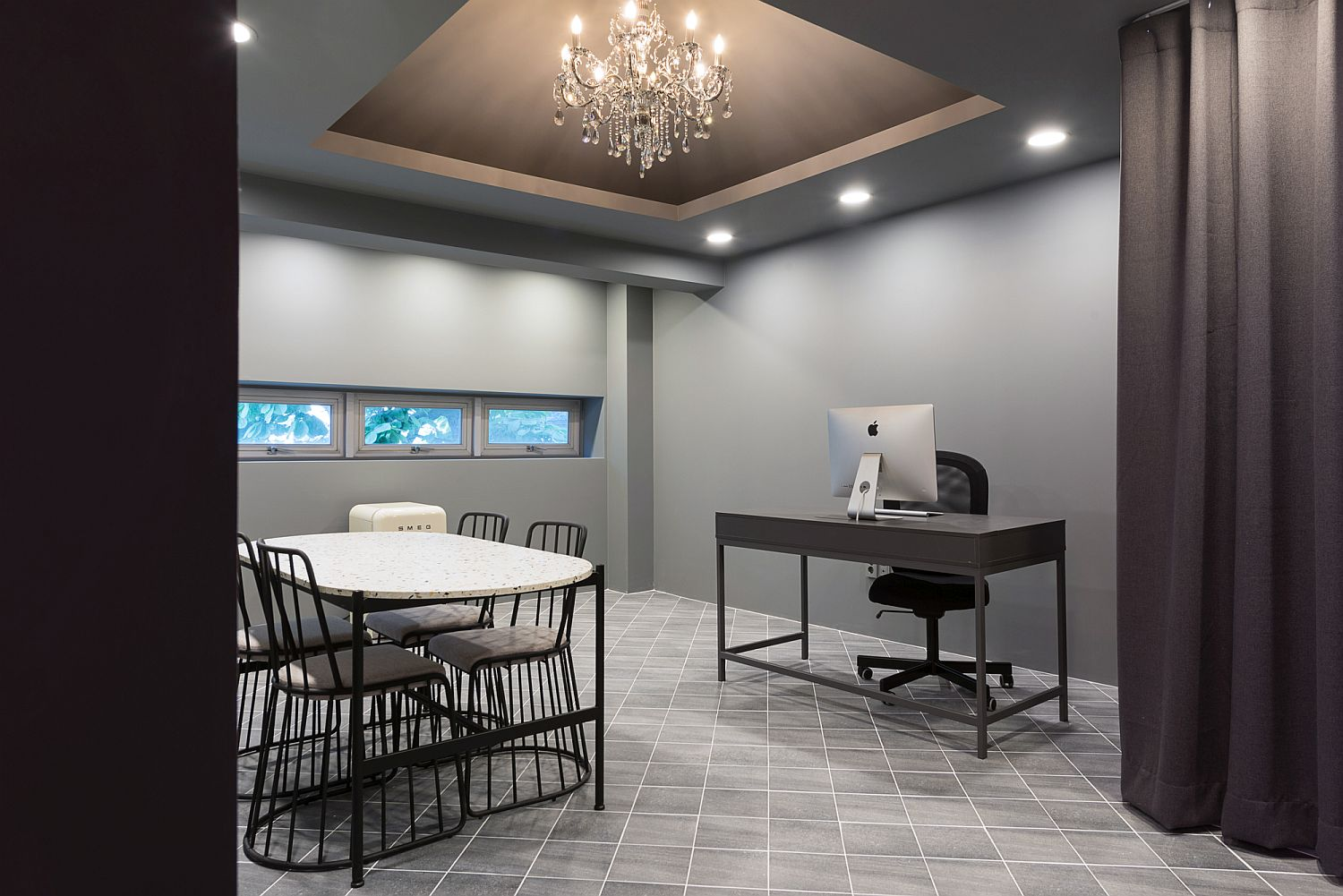 Gorgeous gray office with a sparkling chandelier