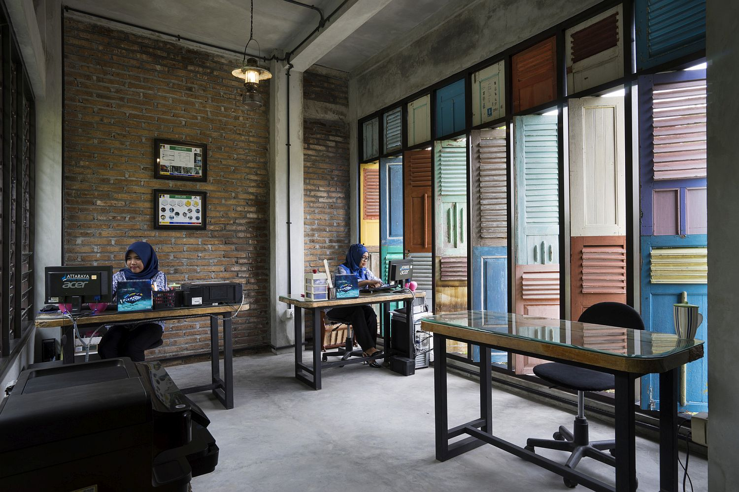 Home office with brick walls and vintage wooden panels