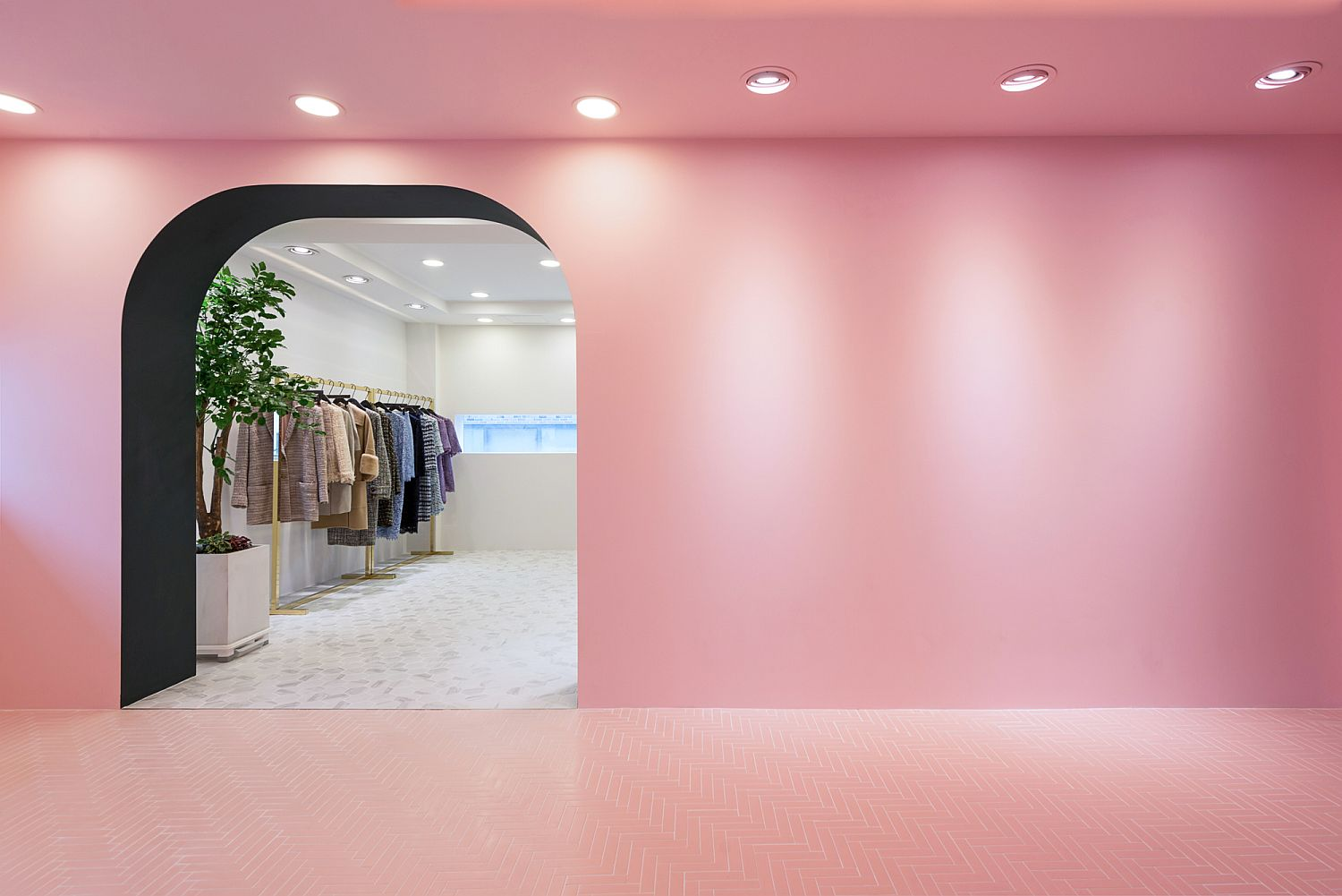 Lighting adds to the ambiance of the all pink entry room