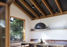 Lofty-ceiling-of-the-kitchen-turns-it-into-the-central-space-of-the-house-217x155