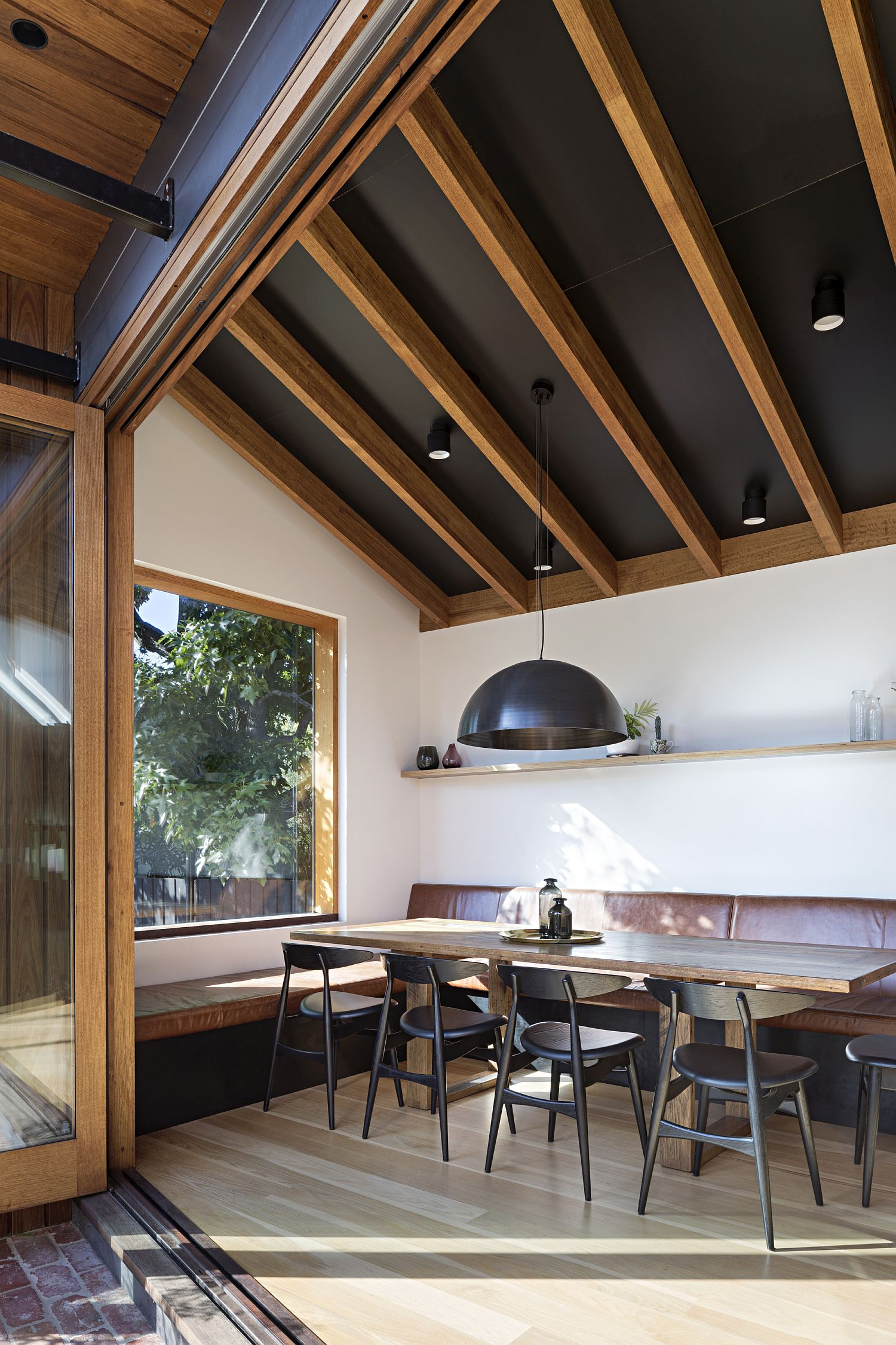 Lofty ceiling of the kitchen turns it into the central space of the house