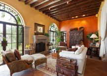 Mediterranean-living-room-with-orange-and-yellow-walls-217x155
