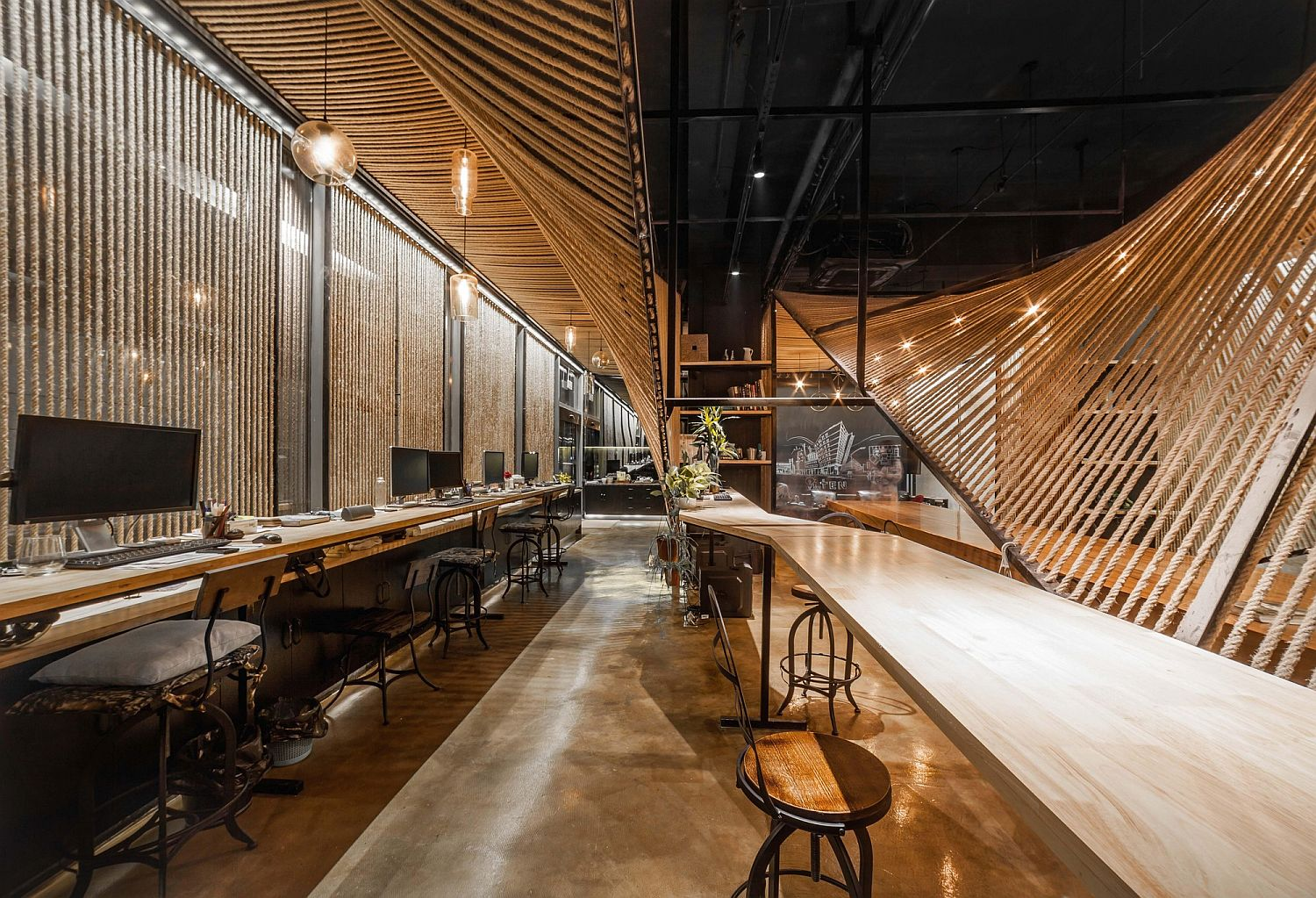 Metal, wood and rope create a stunning sharing office