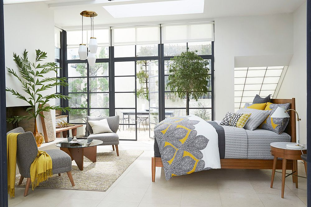 Midcentury modern bedroom in gray and white with yellow accents