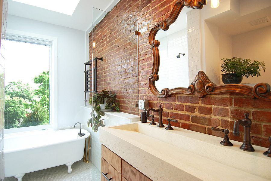 Mirror frame adds to the classic appeal of this bathroom with brick and glass walls