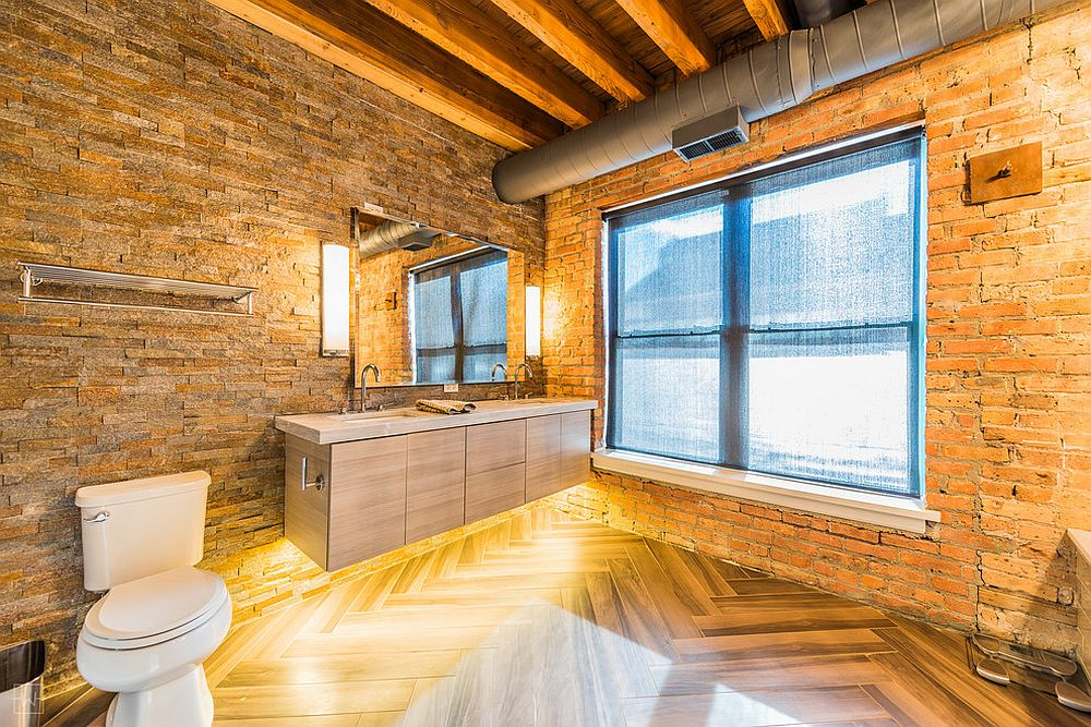 Modern industrial bathroom with gorgeous brick walls