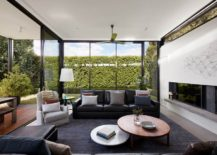 New-living-area-with-glass-walls-and-sliding-glass-doors-completly-opens-up-to-the-rear-garden-217x155