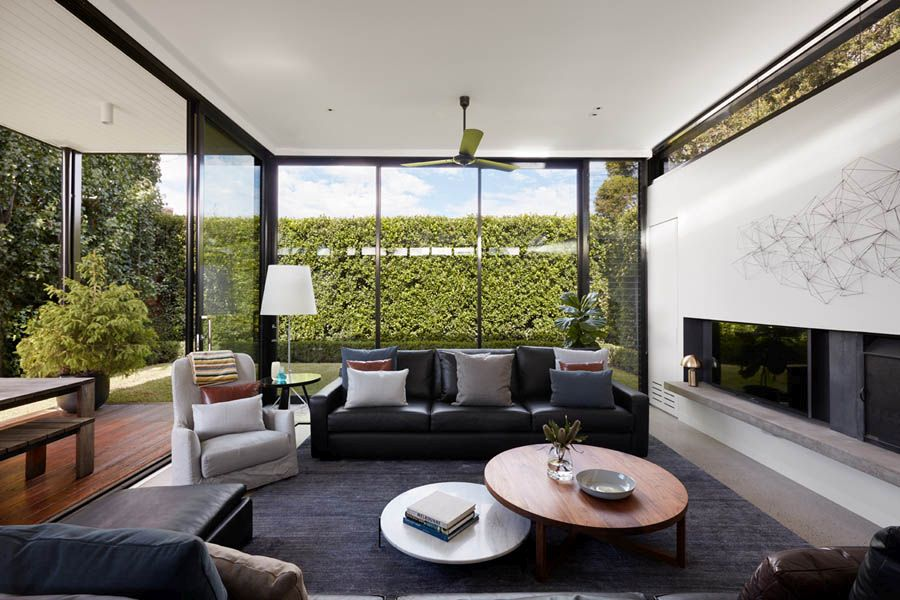 New living area with glass walls and sliding glass doors completly opens up to the rear garden