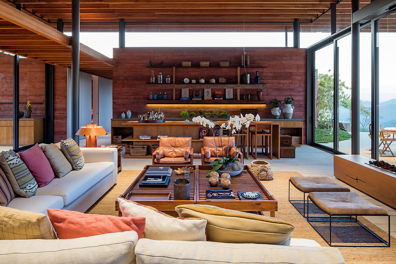 Open interior of the Brazilian home with glass and pigmented concrete walls