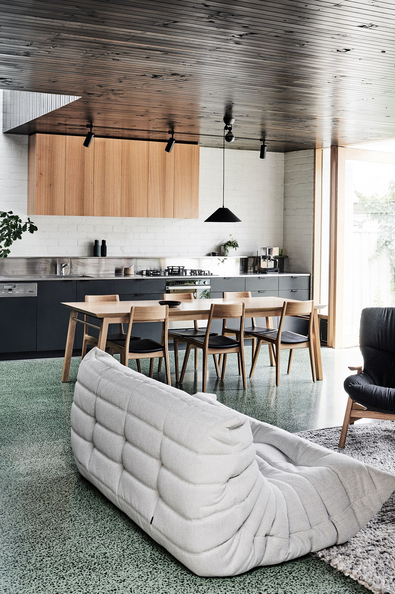 Open plan living area and kitchen of Brunswick West House