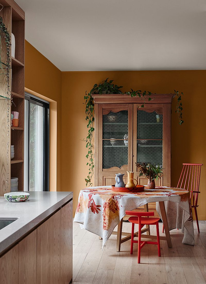 Orange adds charm and brightness to the dining room
