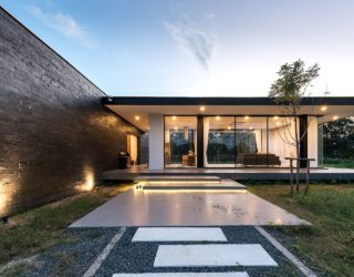This Open Thai Home with Glass Walls is Encircled by a Flower Garden