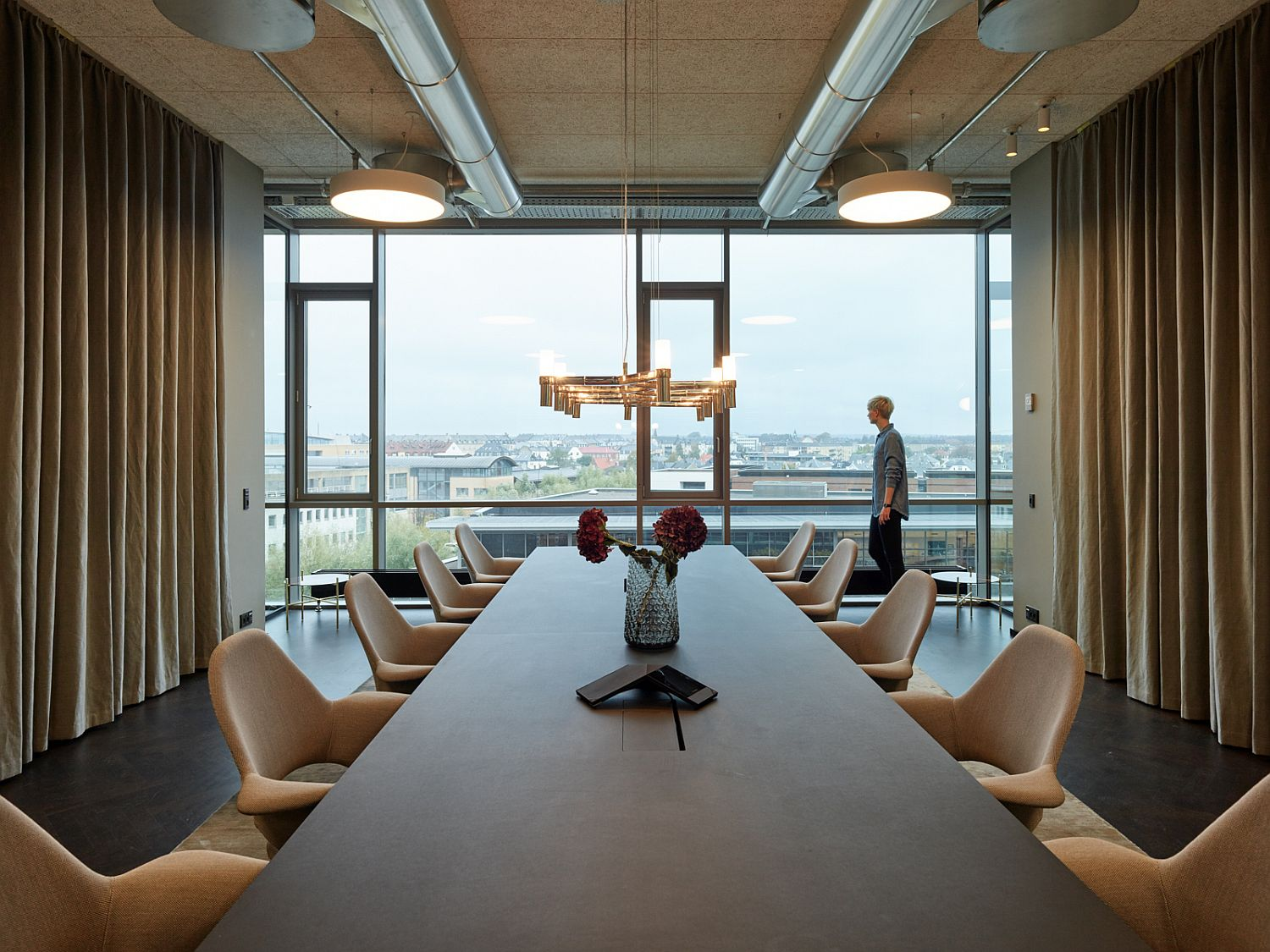 Polished and modern office room with a view of the city